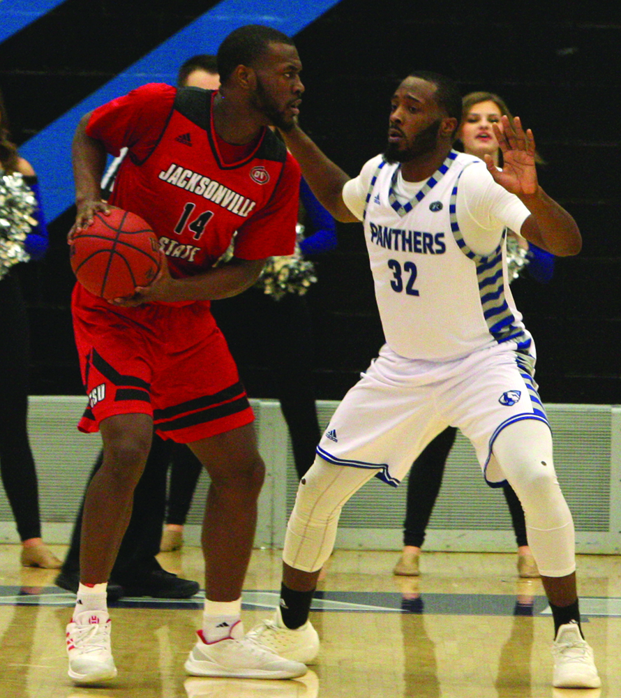 Jacksonville State's Jason Burnell (14) works on Eastern's JaQualis Matlock in the Gamecock's 89-84 win over Eastern on Feb. 28 in Lantz Arena. Jacksonville State finished OVC play with a 15-3 record.