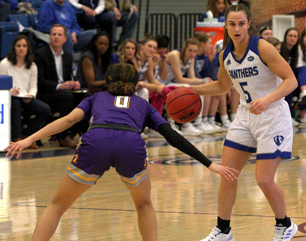 Eastern senior Grace Lennox directs the court during Eastern's 68-51 loss to Tennessee Tech on Saturday in Lantz Arena. Lennox, Jalisha Smith, Halle Stull and Carmen Tellez all played their final game on Saturday.