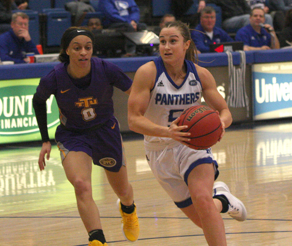 Eastern point guard Grace Lennox drives the basket in her final game as a Panther against Tennessee Tech on March 2. Lennox scored eight points and played 39 minutes in the loss.