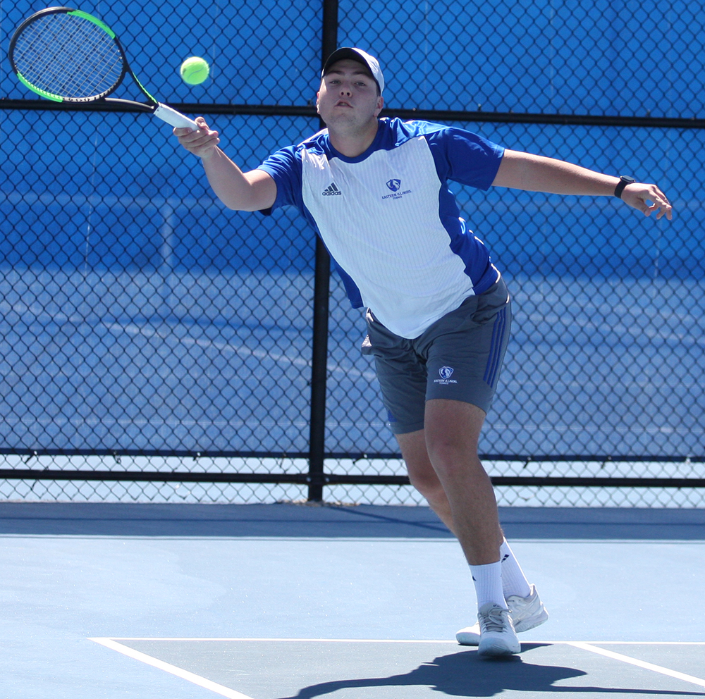 Gage Kingsmith lunges forward to return a hit during the Eastern men's tennis team's 7-0 loss to Belmont at the Darling Courts in March 2018.