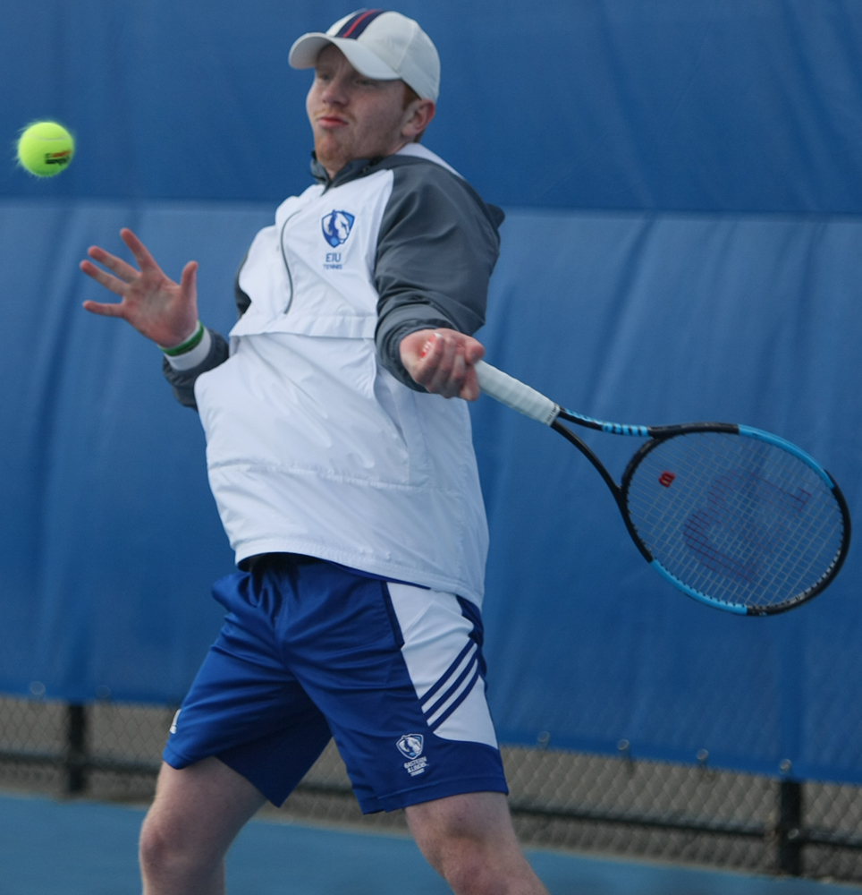 Freddie O'Brien rears back to return a hit in his singles match during Eastern's 6-1 loss to Jacksonville State at the Darling Courts Friday.