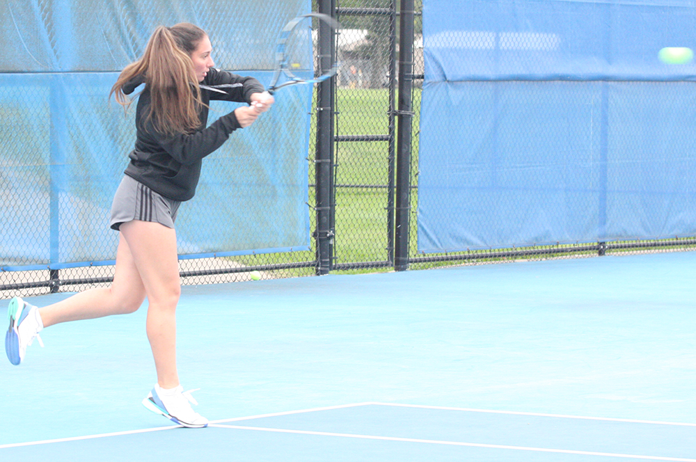 Rachel Papavasilopoulos hits a back-handed shot in the middle of a volley with Emily Pugachevsky during practice at the Darling Courts in October 2018.