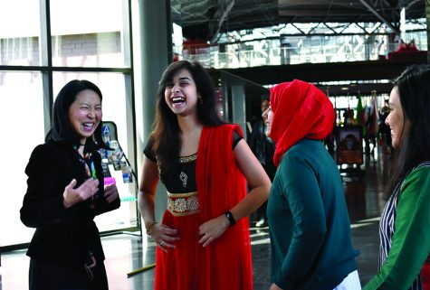 Jinhee J Lee, a professor of history, coordinator of Asian Studies and the main organizer for Asian Heritage Month, talks with students during the Kick-off Reception in the Doudna Concourse of the Doudna Fine Arts Center on Monday afternoon.