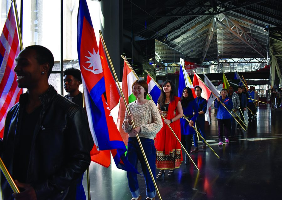 The Asian Heritage Month Kick-off Reception begins with a flag procession at the Doudna Fine Arts Center on Monday afternoon.