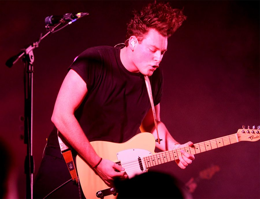 Jordan Greenwald, guitarist for Lovelytheband, puts on a performance during the Lovelytheband concert at McAfee Gym.