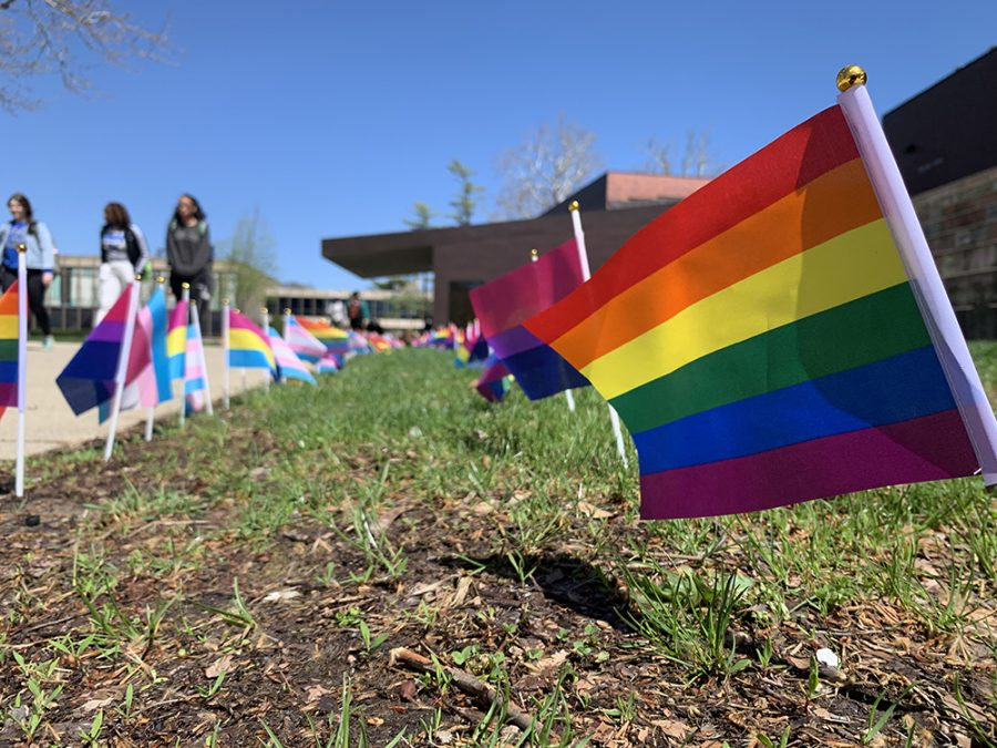 Flags+representing+the+LGBTQ+community+wave+in+front+of+the+Doudna+steps+Friday+as+part+of+a+vigil+for+the+National+Day+of+Silence.