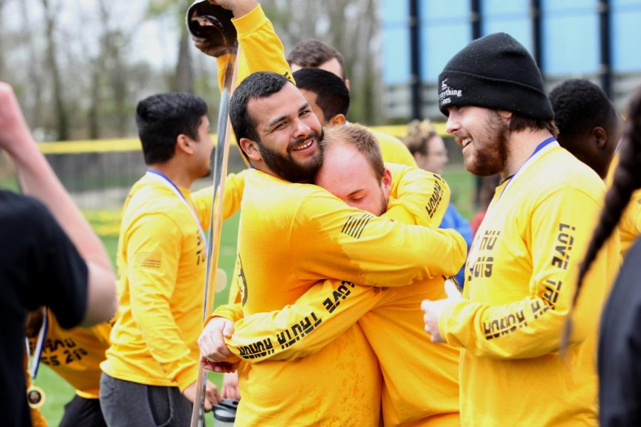 Members of Sigma Nu celebrate after winning the Tugs championship Saturday afternoon at the Campus Pond.