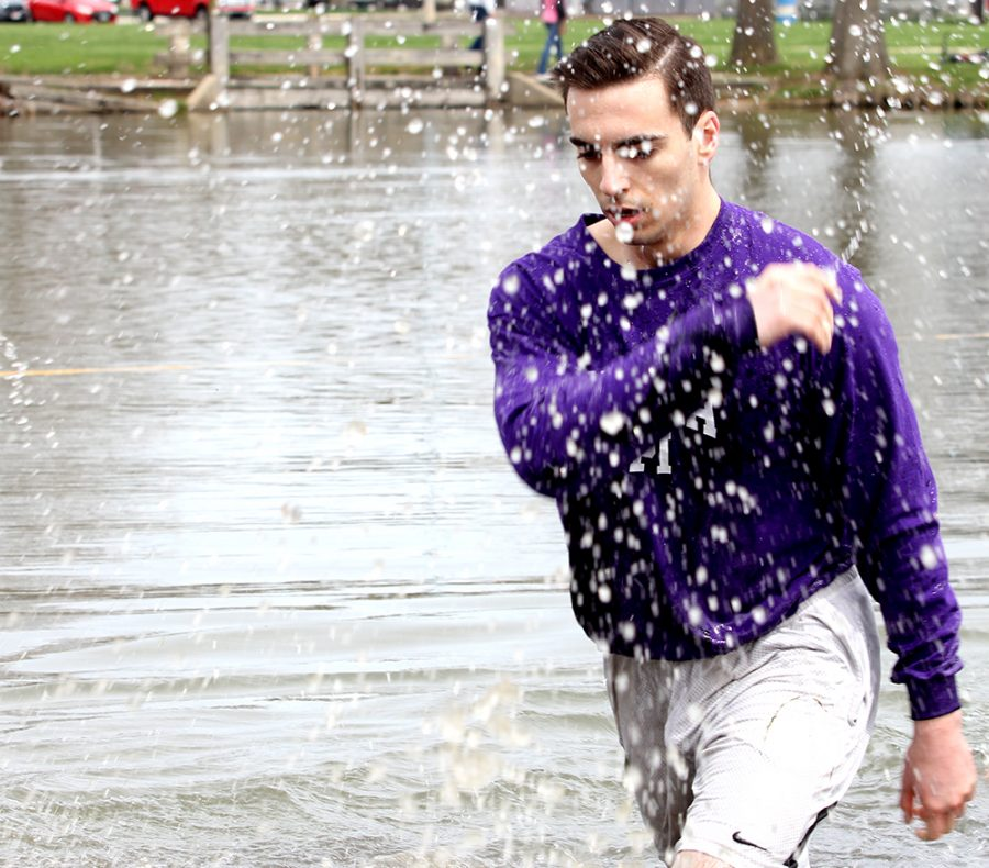 A member of Sigma Pi splashes the water after his team lost against Sigma Nu Saturday during the Tugs Championship. Sigma Nu came in second and Sigma Phi Epsilon came in third.