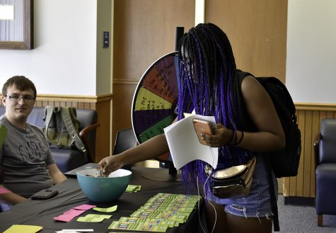 Kayla Ruth, a freshman in Early Childhood Education major, picks candies after answering question about budget during How to Beat the Game of Life event in the Alumni Lounge in the second floor of the Martin Luther King Jr. University Union Tuesday afternoon.