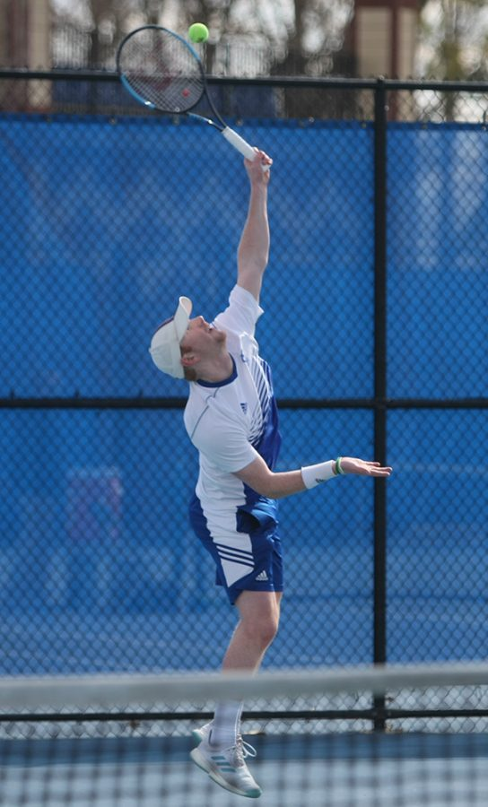 Eastern's Freddie O'Brien serves a ball in the Panthers' 6-1 loss to Jacksonville State on March 22 at the Darling Courts. Eastern beat Alabama 4-3 on Sunday.