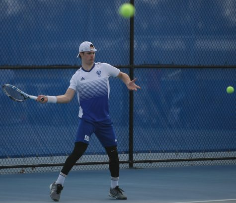 Mike Jansen winds up to return his opponents' hit in his singles match during Eastern's 6-1 loss to Jacksonville State March 22 at the Darling Courts.