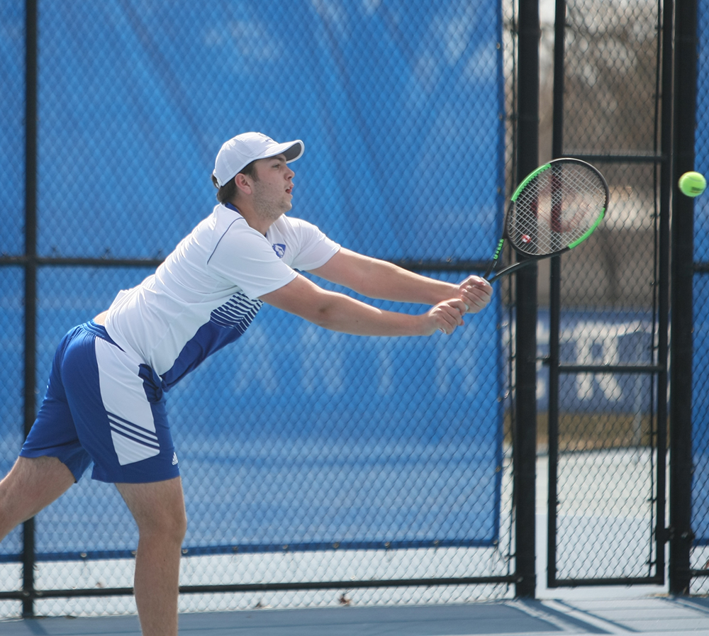Dillan Schorfheide | The Daily Eastern News Gage Kingsmith lunges to return a hit in a doubles match during the men's tennis team's 6-1 loss to Jacksonville State March 22 at the Darling Courts.