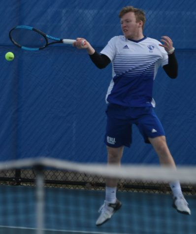 Logan Charbonneau returns a hit during the Eastern men's tennis team's 6-1 loss to conference foe Jacksonville State March 22 at the Darling Courts.