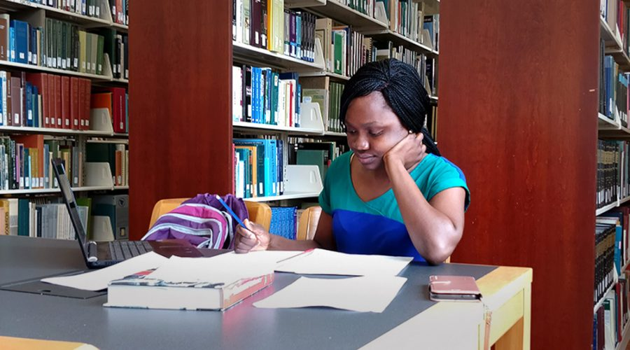 Portia Mensah, a graduate student majoring in economics, studies in Booth Library for her international economics course Tuesday afternoon.