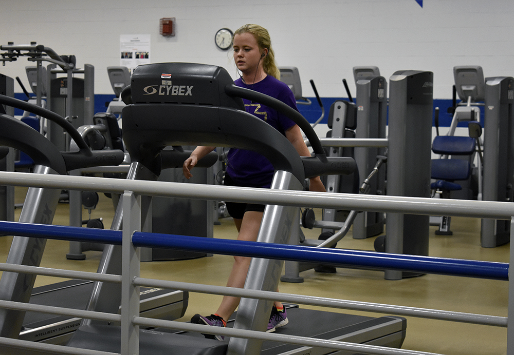 Leslie Hearn, a communication disorders and sciences graduate student, walks on a treadmill Wednesday afternoon in the second floor of the Student Recreation Center.
