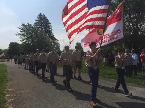Members of Boy Scout Troop 141 march in honor of those who died in military service during the Memorial Day ceremony at Roselawn Cemetery.