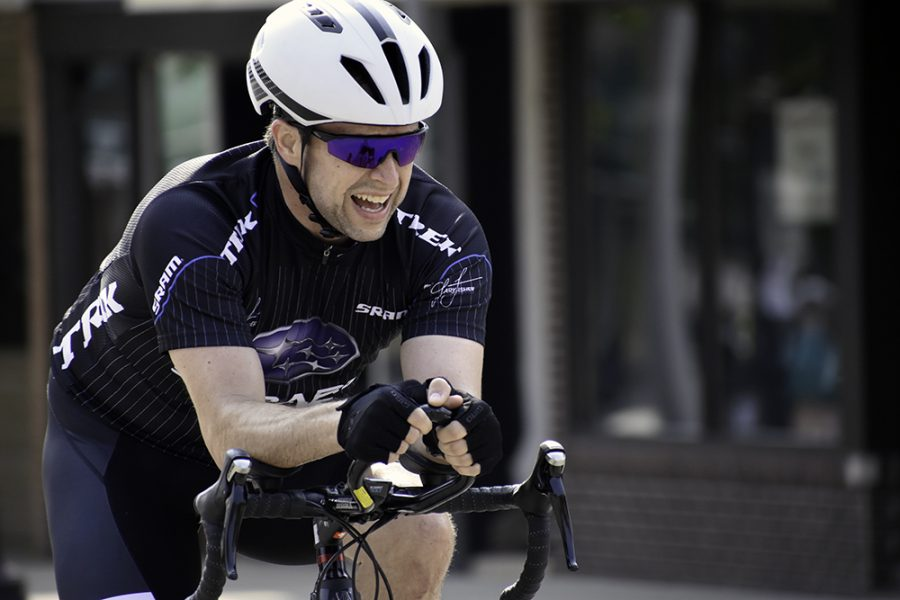 Justin Blue, a car salesman from Champaign, finishes the 25-mile route in first place during the Tour de Charleston on June 1.