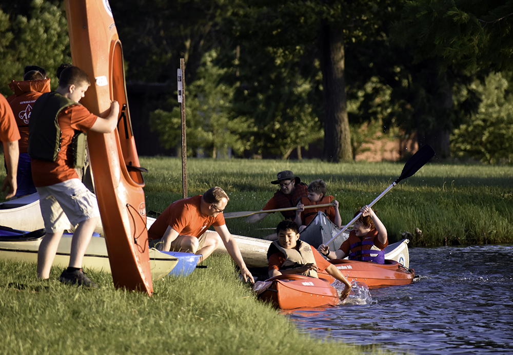 Boy Scout Troop 141, part of Charleston Wesley's ministry to youth, row kayaks at the Campus Pond Monday afternoon.