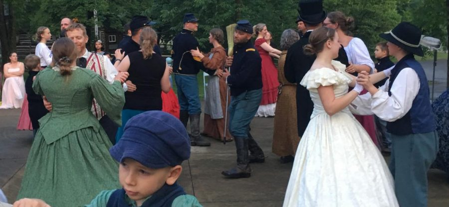 Dancers at the Lincoln Log Cabin Civil War Ball mix and mingle during the Broom Dance on June 15.