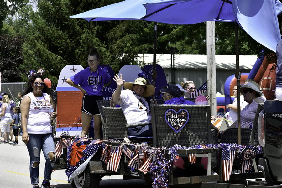 People on a patriotic float in the parade celebrate the Charleston Red, White and Blue Days Thursday afternoon.