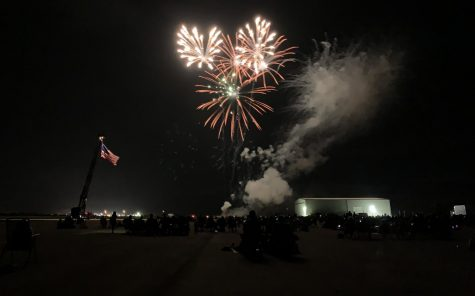 People watch as the fireworks finale takes place at the Cole Coles County Airport during the Fourth of July celebration.