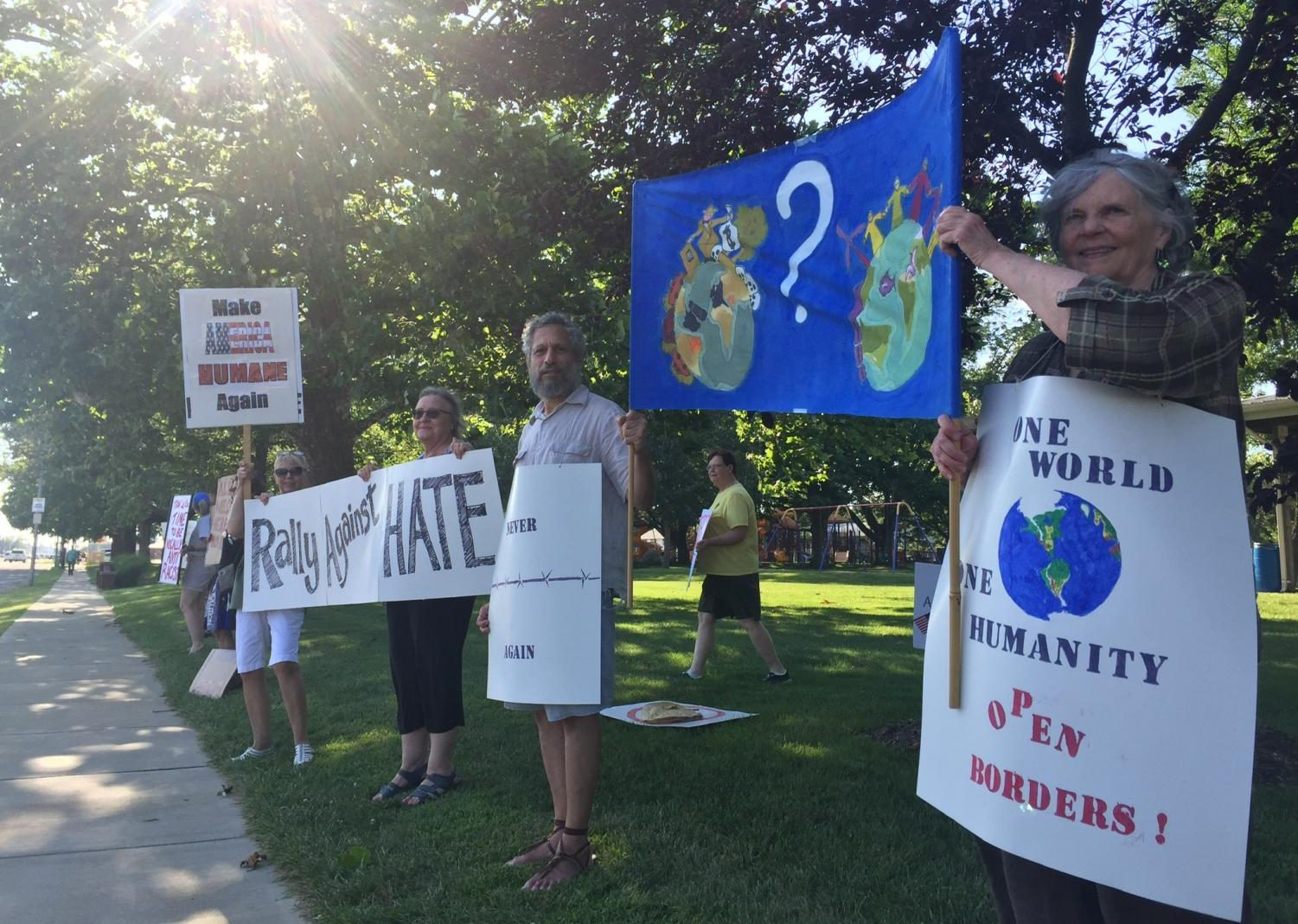 Members of the Coles County community protest government policies and local white supremacy at Morton Park Thursday evening.