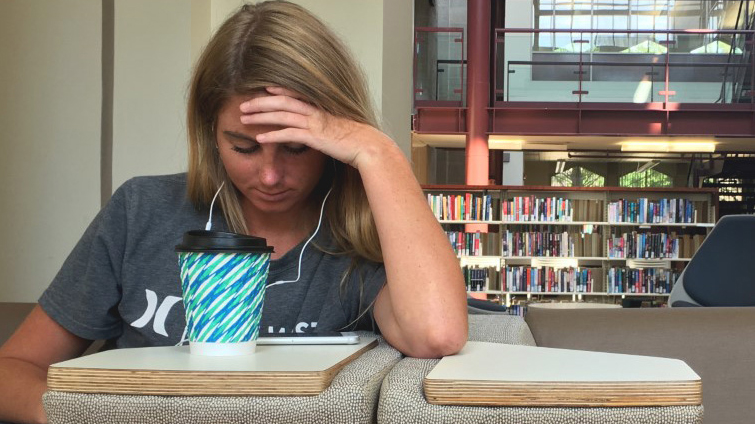 Mckenna Wyand, a senior marketing major, takes a break between classes in the basement of Booth Library Wednesday.