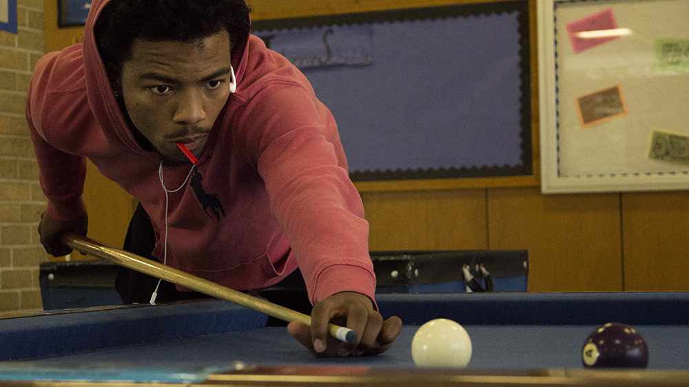 Adjani Reeves, a sophomore exercise science major, plays pool with his friends in the Thomas Hall Lobby Sunday afternoon.