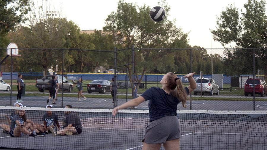 Rachel Schell, a freshmen majoring in bussiness finance, is playing volley ball at Rim Rocker/Volleybrawl for freshmen at the courts outside of Lantz Arena on Tuesday night.