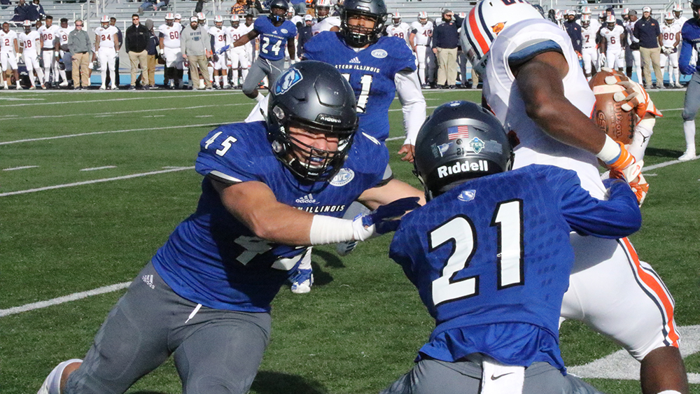 File Photo | The Daily Eastern News Eastern linebacker Joe Caputo (left) and defensive back Mark Williams team up to bring down a Tennessee Martin ballcarrier on Oct. 20 last season. The Panthers won the game 24-21 in overtime.