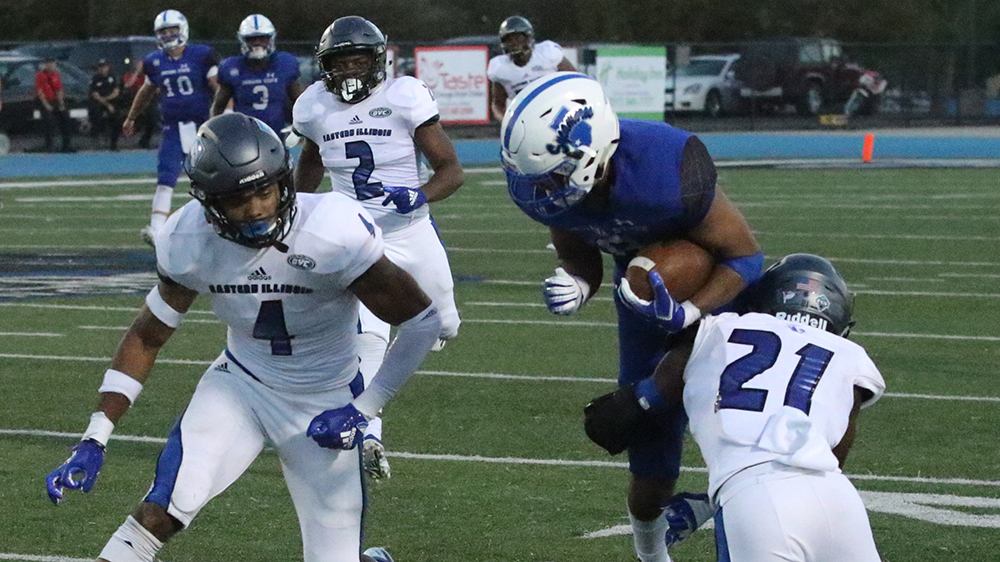 File Photo | The Daily Eastern News Mark Williams (right) tackles an Indiana State ball carrier as Raymond Crittenden (left) gets ready to help out during Eastern's 55-41 loss in September 2018 at O'Brien Field.