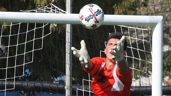 File Photo | The Daily Eastern News Eastern goalkeeper Jonathan Burke skies over an attacker to make a save during the men's soccer team's double-overtime 1-1 tie with Evansville in August 2018 at Lakeside Field.