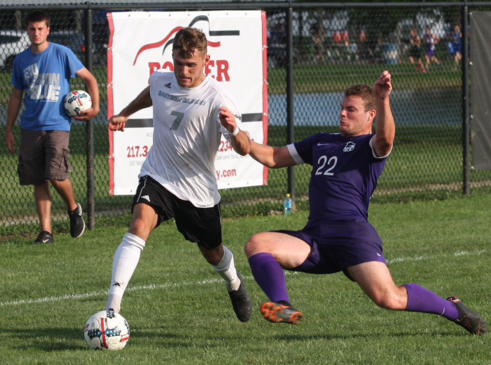 File Photo | The Daily Eastern News Jake Andrews fends off a sliding defender while making a move with the ball during Eastern's 0-1 loss to Green Bay at Lakeside Field in September 2018.