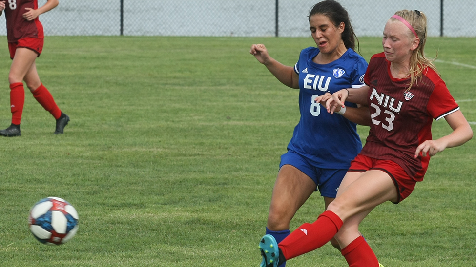 Dillan Schorfheide | The Daily Eastern News Eastern forward Pilar Barrio bumps a defender to try to get the ball back during the women's soccer team's 1-1 tie with Northern Illinois Friday at Lakeside Field.