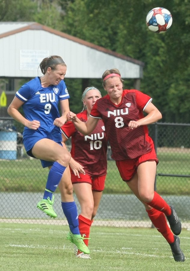 Dillan Schorfheide | The Daily Eastern News Sarah DeWolf attempts a header toward the Northern Illinois goal during Eastern's 1-1 tie with Northern Illinois in an exhibition match Aug. 16 at Lakeside Field.