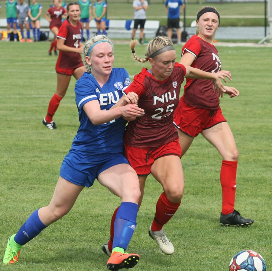 Dillan Schorfheide | The Daily Eastern News Niondina Nystrom fights for position to get the ball against a Northern Illinois defender during Eastern's 1-1 tie with Northern Illinois in an exhibition match Friday at Lakeside Field.
