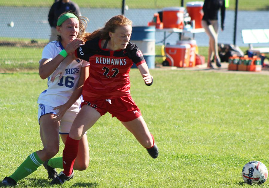 File Photo | The Daily Eastern News Kayla Stolfa fights for position against a Southeast Missouri attacker during the Eastern women's soccer team's 0-1 loss at Lakeside Field in October 2018.