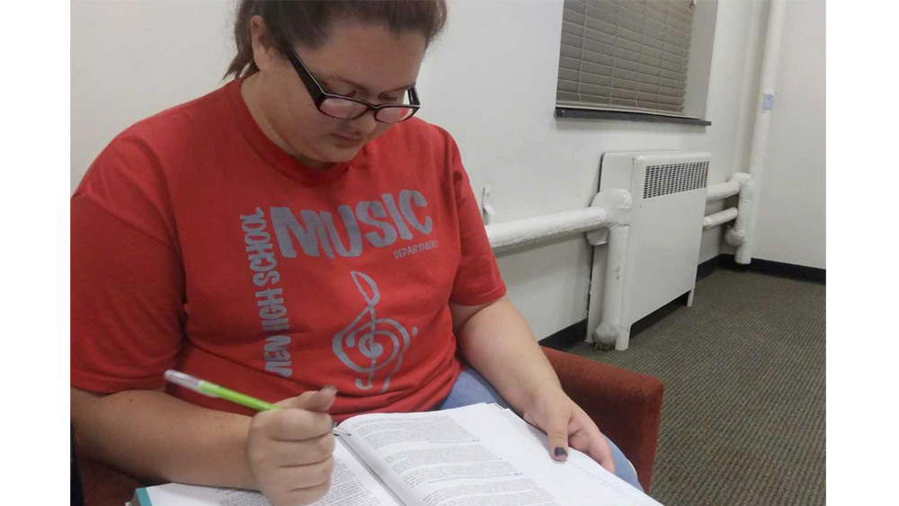 Hope Porter, a sophomore special education major, studies in the basement of Pemberton Hall Monday night. She said she had a relaxing weekend, and her stepmom was able to come up from Tennessee to visit. She added that she was able to get her stepmom to try Freddies Custurd for the first time in Mattoon.