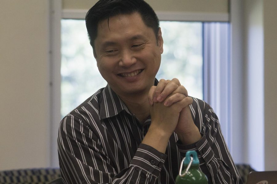 Kai Hung, a biology professor, laughs during the Sept. 5 2019 CAA meeting in Room 4440 of Booth Library. The council voted to approve 21 nursing program items and to consider weighted GPAs during the admission process.