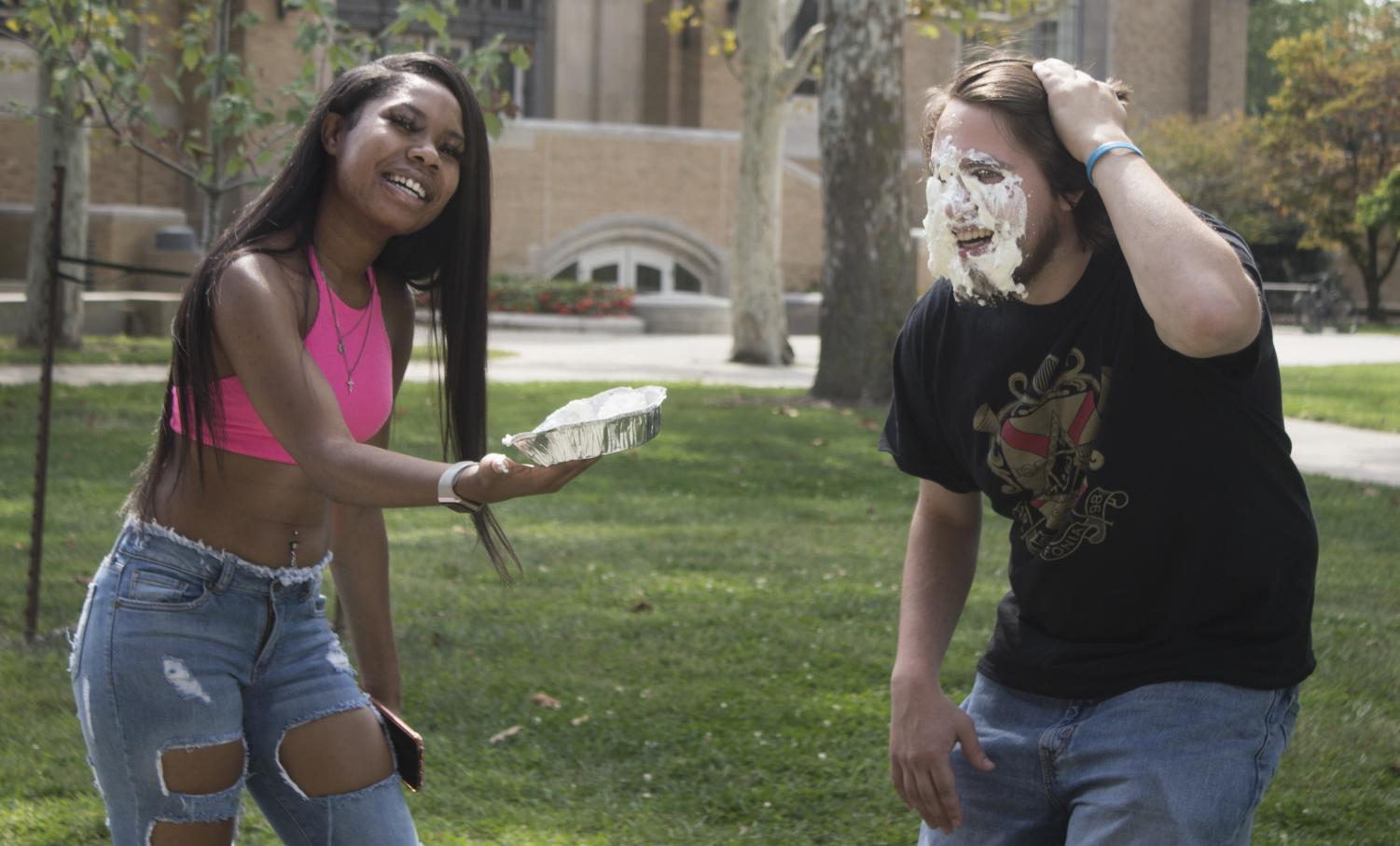 "Summer Jacobs | The Daily Eastern News ""How should I smack you?"" asked Armoni King, a sophmore bussiness and marketing major, before pushing a pie into Mikey Meyer's face, who is a transfer music education major, at the Library Quad on Tuesday afternoon."