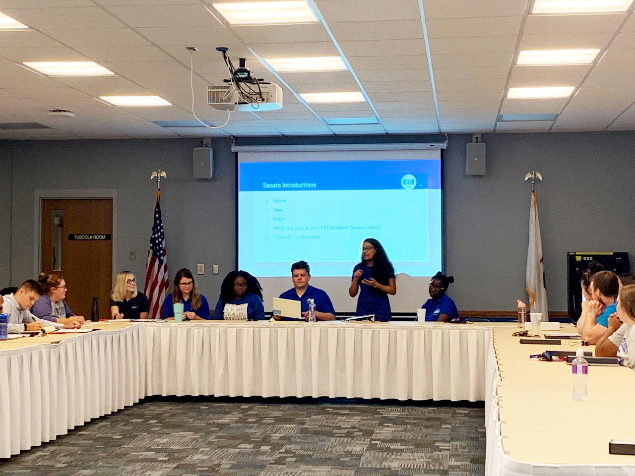 """Student Senate introduce themselves individually by stating their fun facts such as their name, year, major, """"What led you to join EIU Student Governement?"""" and how far have their shoes gone to."""