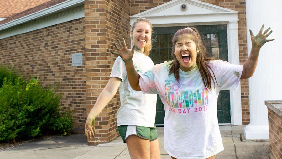 Kendall+Kurza%2C+a+junior+psychology+major%2C+surprises+Alyssa+Bitner%2C+a+sophomore+communication+disorders+and+sciences+major%2C+with+chalk+powder+during+a+Kappa+Delta+Sorority+sisterhood+event+on+Tuesday.