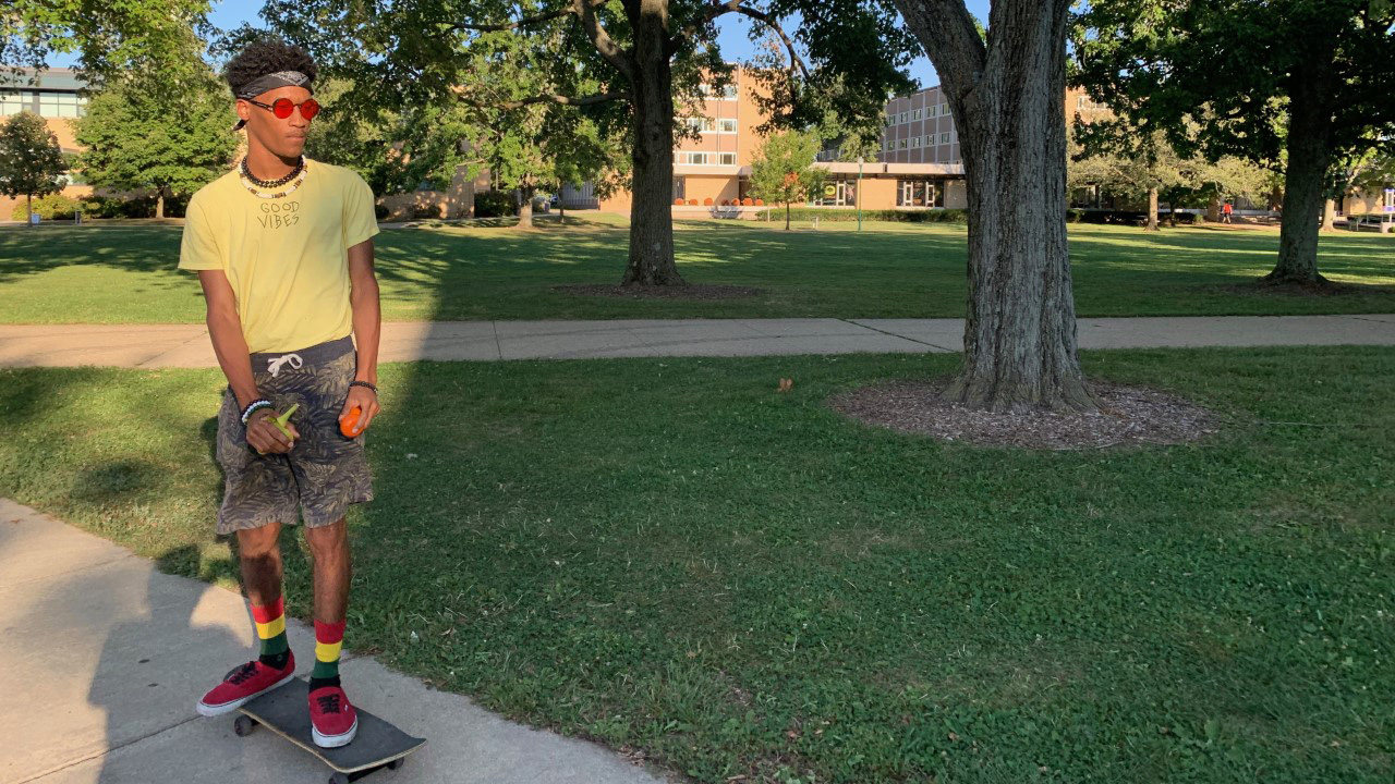 "Coby Oliver, an undecided freshman, skateboards back to Taylor Hall Wednesday afternoon. Oliver was skateboarding back from Mindfulness Club and received free fruit while at the club. Oliver explained he skates around on campus ""for the most part."""