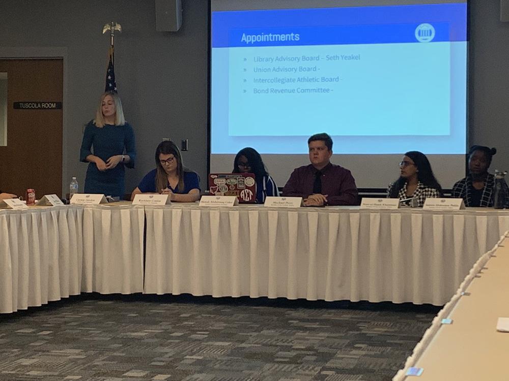 Eastern Student Body President Carson Gordon (far left) speaks at Student Senate Wednesday night. The senate discussed the diversity action council.