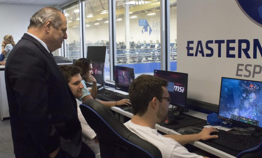 President David Glassman asked students about the games they played as he watched behind them in the eSports arena at the Student Recreation Center after the ribbon cutting ceremony on Monday afternoon.