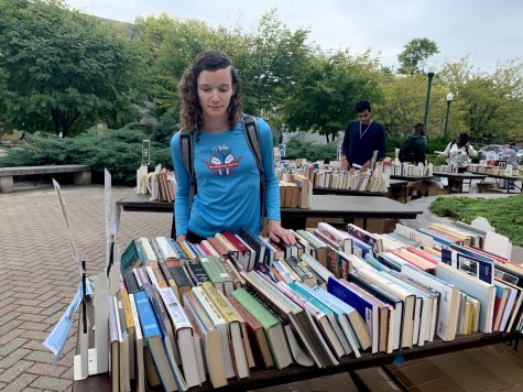 Danielle Lindblad, a graduate student studying exercise science looks through the religious section. Lindblad was trying to find a Koran but was unable to find one but continued to look through the books to see what she can find.