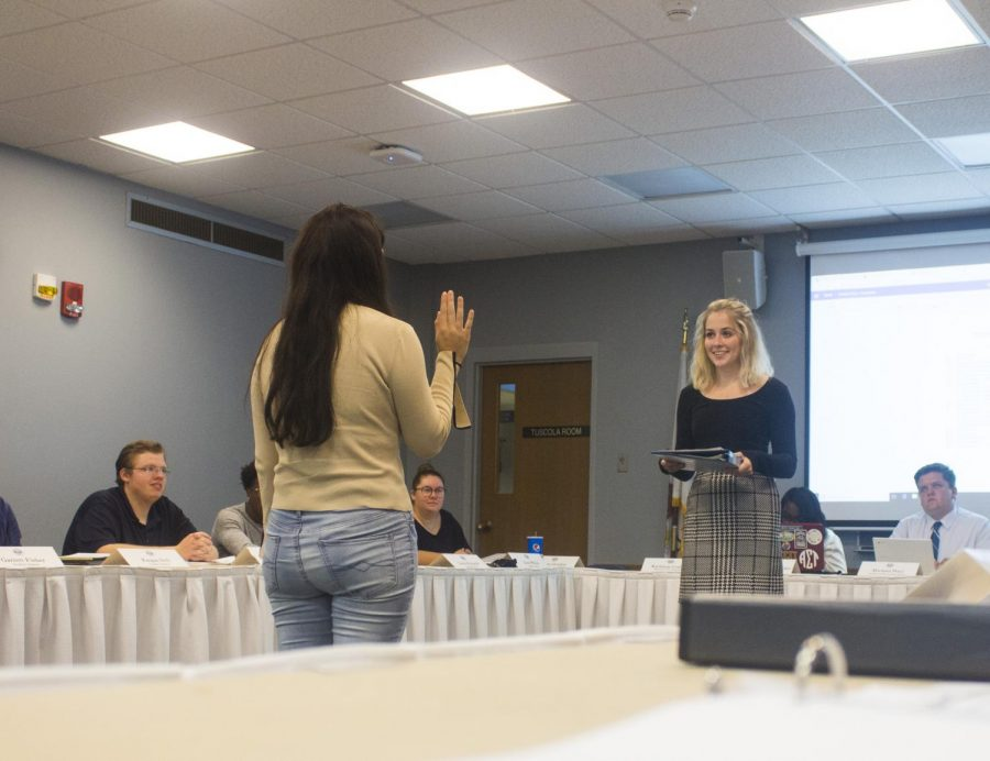 John Olson | The Daily Eastern News  Student Body President Carson Gordon appoints Miranda Martinez, a sophomore communication disorders & sciences major, into the Student Senate at the Martin Luther King Jr. University Union during the Student Senate meeting.