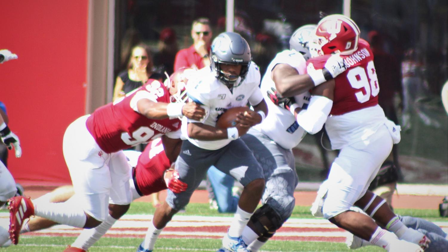 Eastern quarterback Johnathan Brantley tries to escape pressure in Eastern's 52-0 loss to Indiana on Saturday. Brantley was sacked twice in the game.
