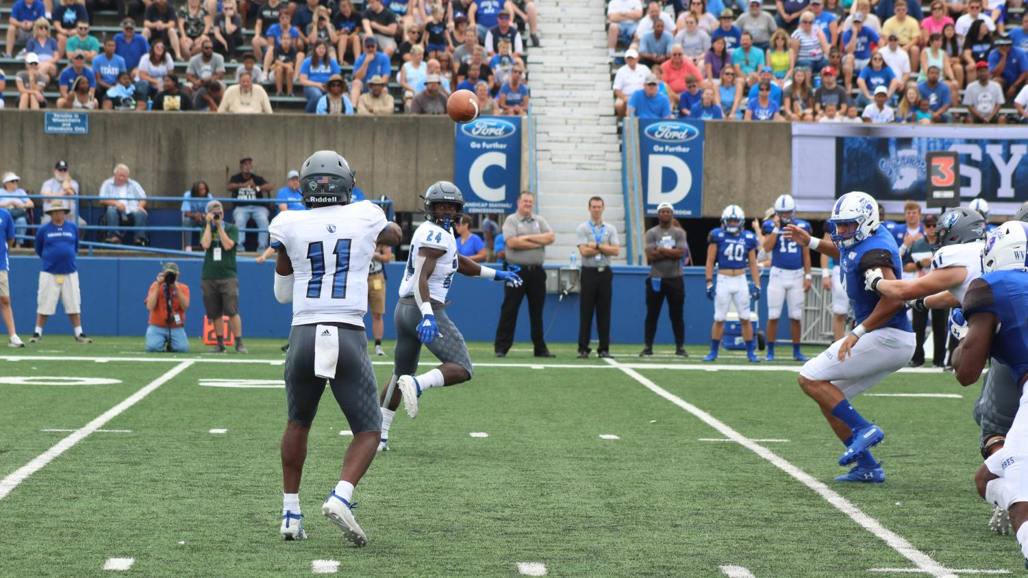 Eastern quarterback Johnathan Brantley throws a pass to Darshon McCullough in Eastern's 16-6 loss to Indiana State Saturday. Eastern had just 200 yards of offense.