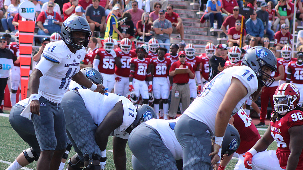 Adam Tumino | The Daily Eastern News Johnathan Brantley calls out commands to his offense before the play. Eastern lost 52-0 to Indiana Sept. 7 at Memorial Stadium.